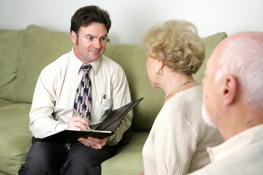 Woman talking to agent about preplanning funeral