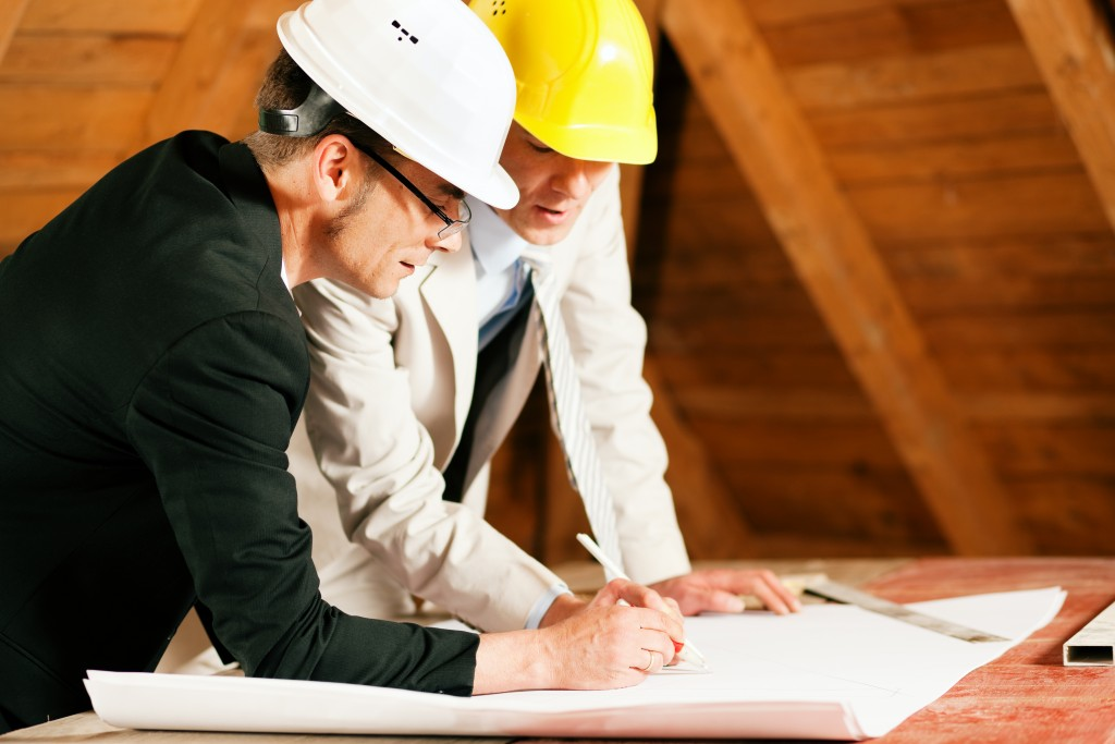Engineer and architect working on a blueprint