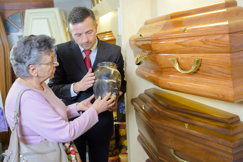 Mother choosing either cremation or burial