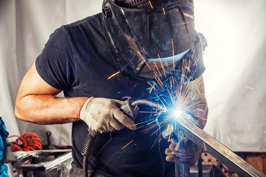 Welder with welder mask working