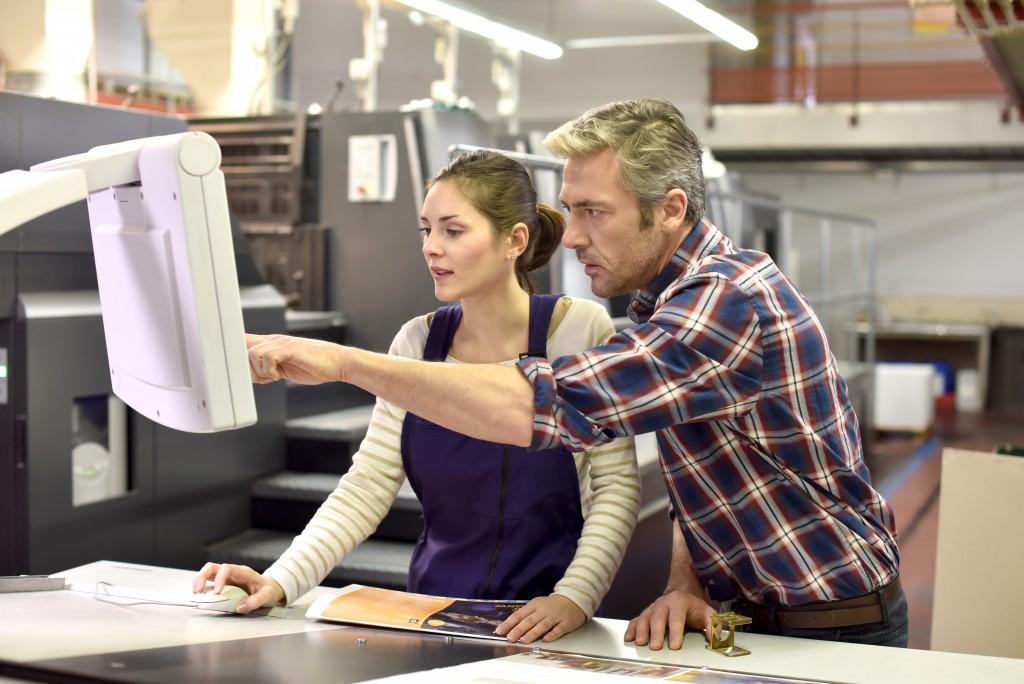man directing printing operations