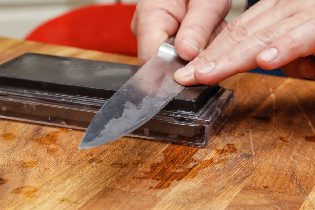 Knife being sharpened