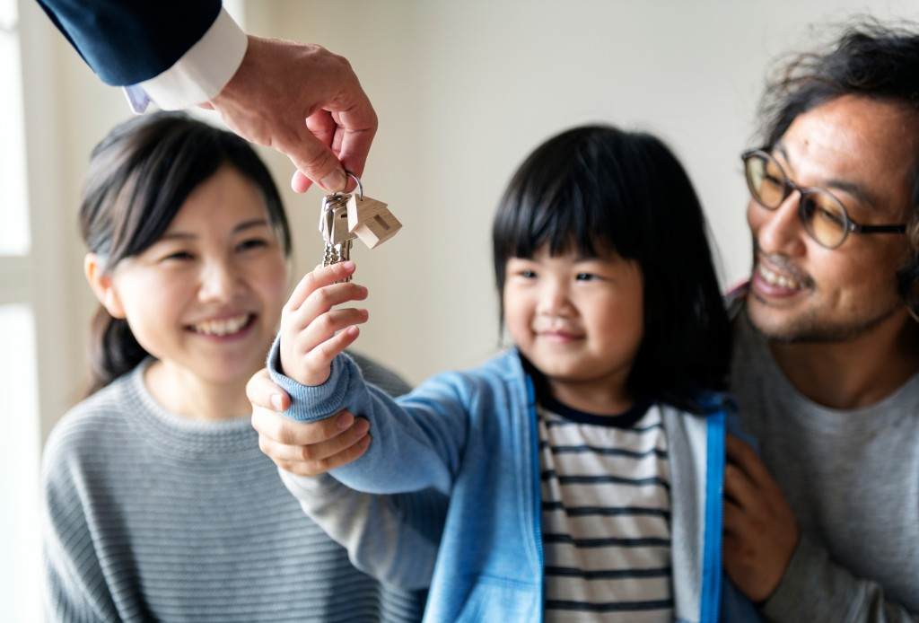 asian family getting a new house
