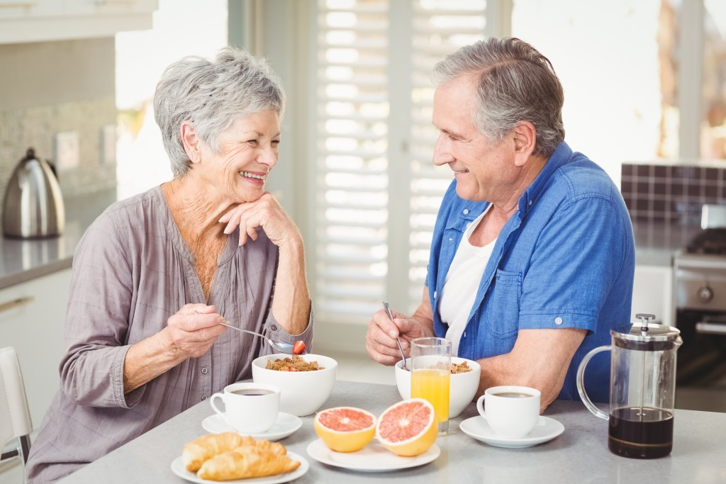 old couple having breakfast