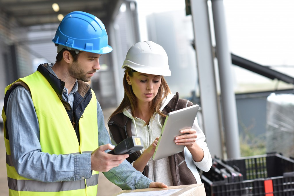 Warehouse manager and employee looking at a tablet