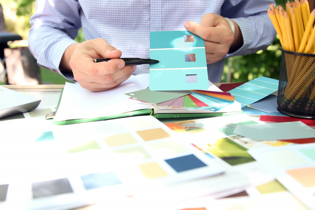 man choosing color for his design