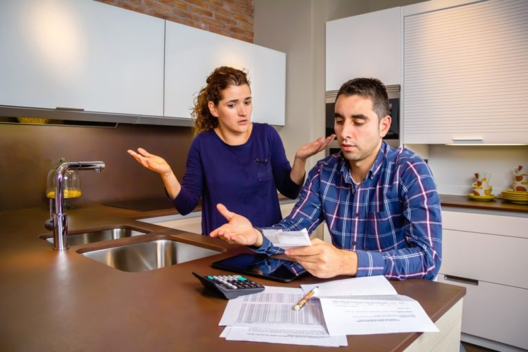 couple with many debts looking at their bills