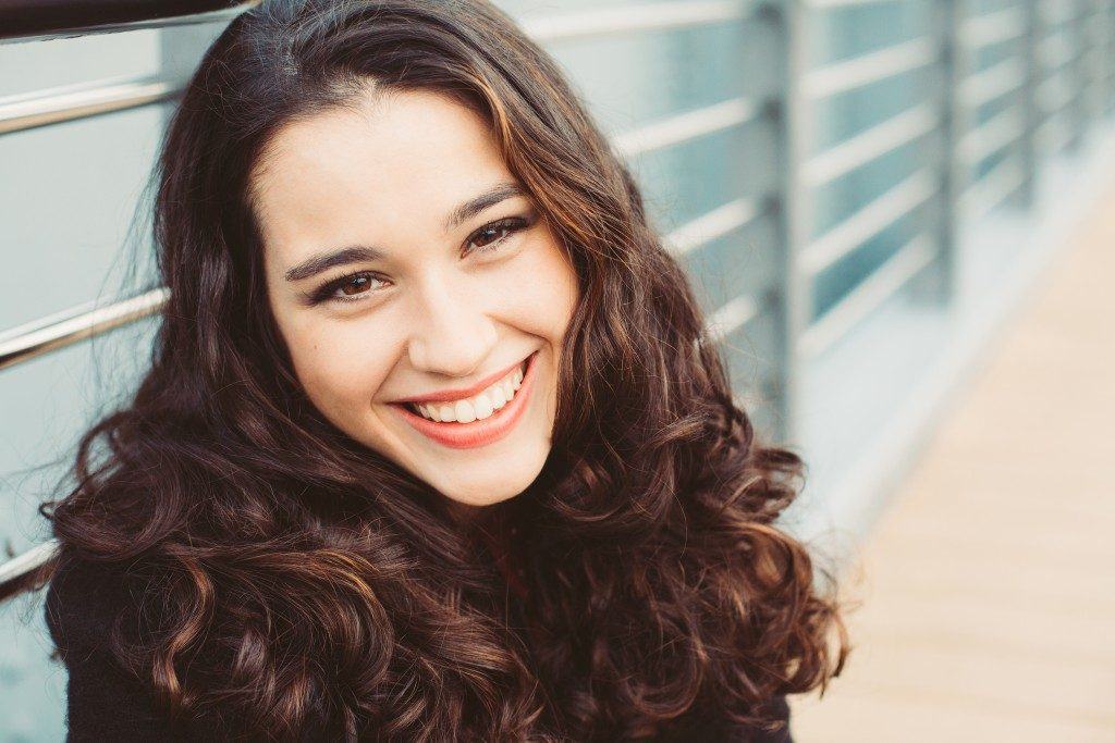 Woman with wavy hair smiling