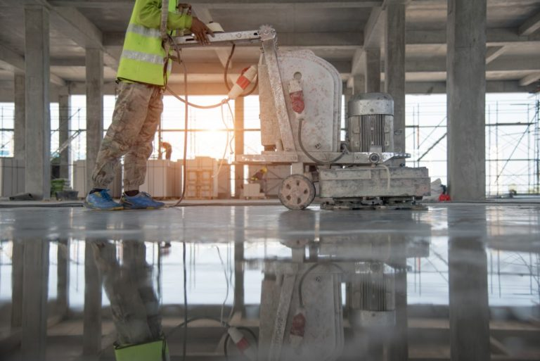 cleaning floor with heavy equipment
