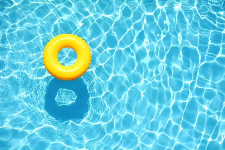 yellow pool float on the water