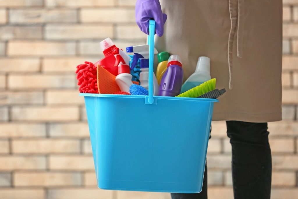 blue bucket with cleaning agents and materials