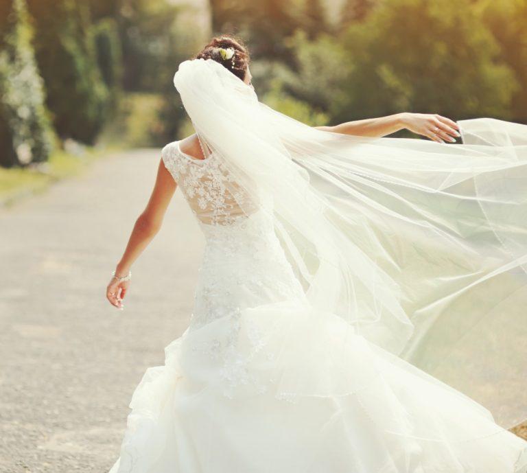 Happy bride spinning around in her dress