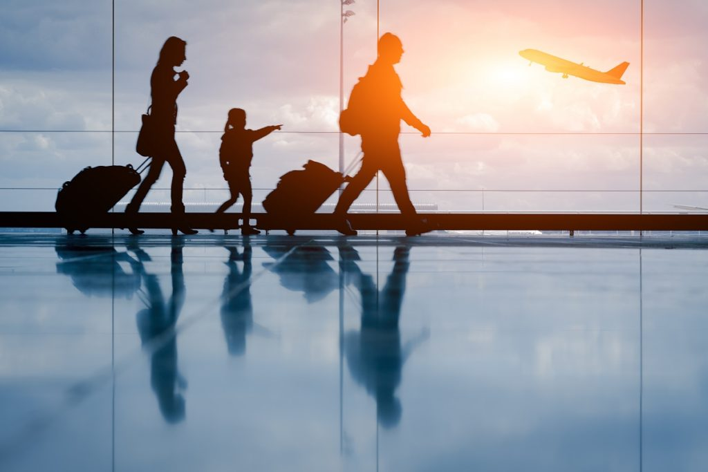 parents and child walking at the airport
