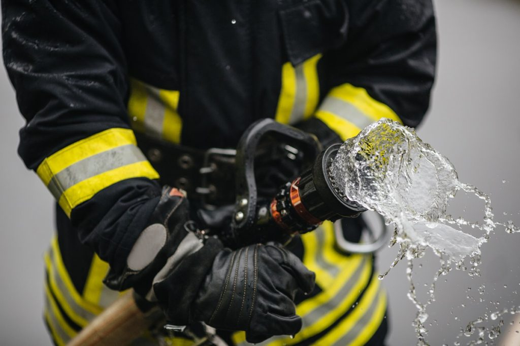 Fireman opening the water hose