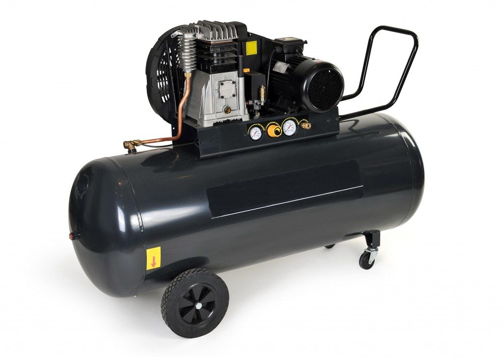Black compressor isolated on a white background