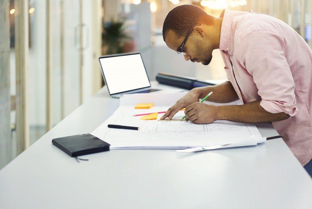 startup entrepreneur designing a blueprint
