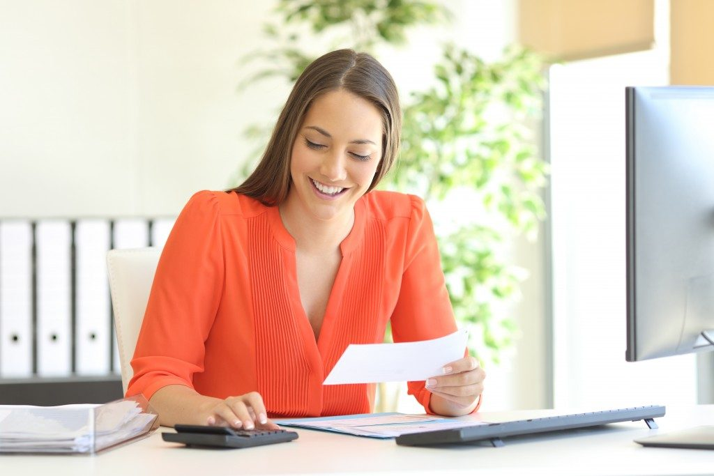 woman working and calculating finances
