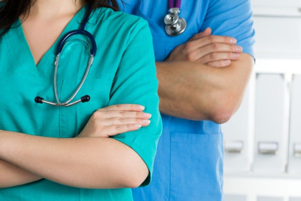 Medical staff wearing scrubs and stethoscope