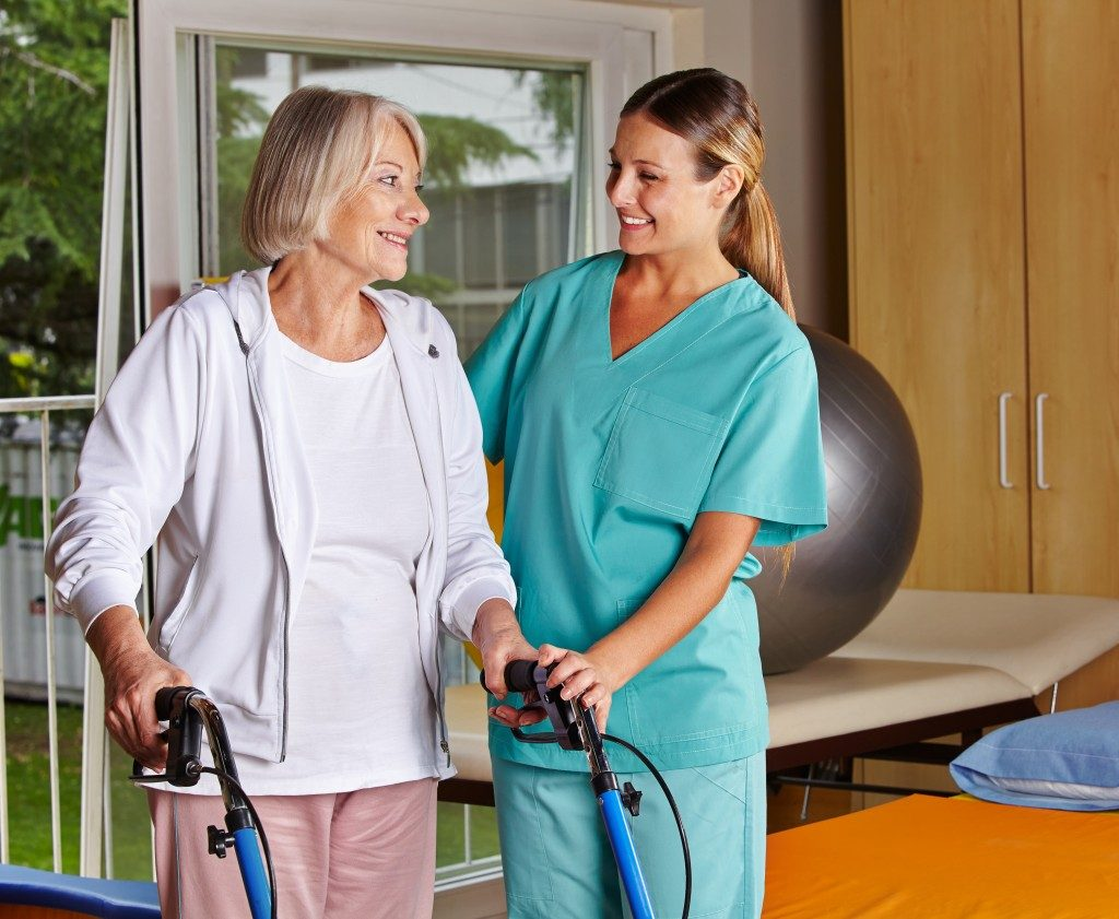 Physical therapist with senior patient