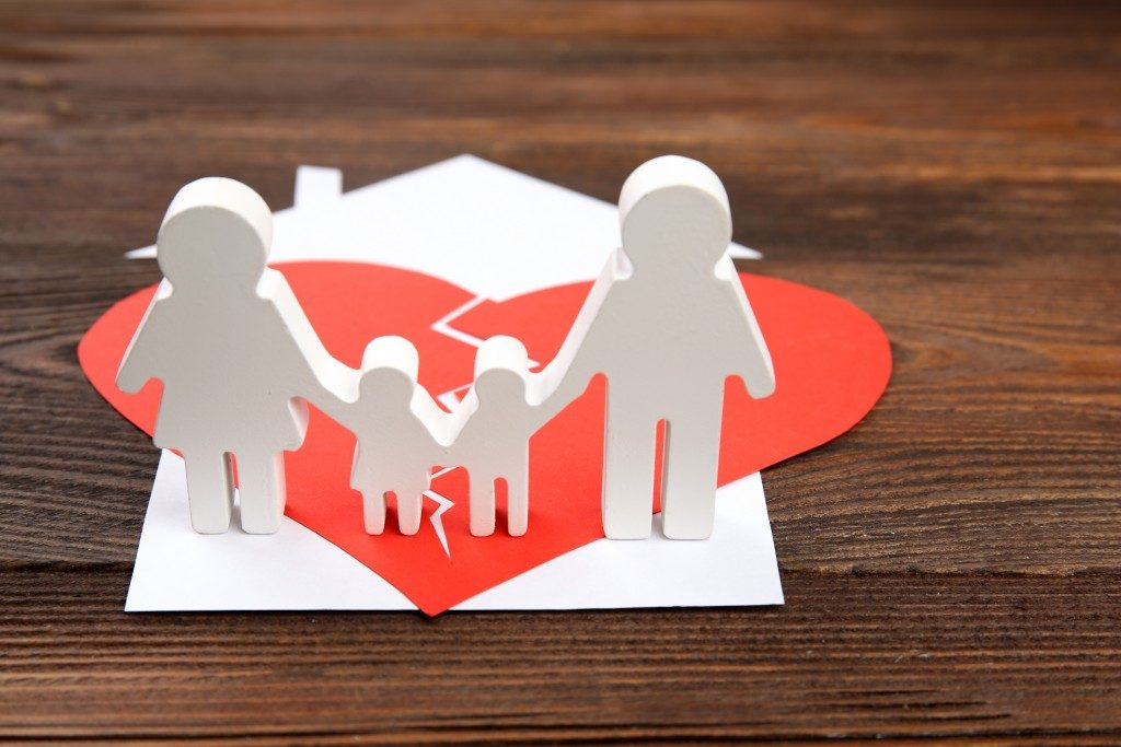 divorce and child custody concept with a broken heart on top of family's house