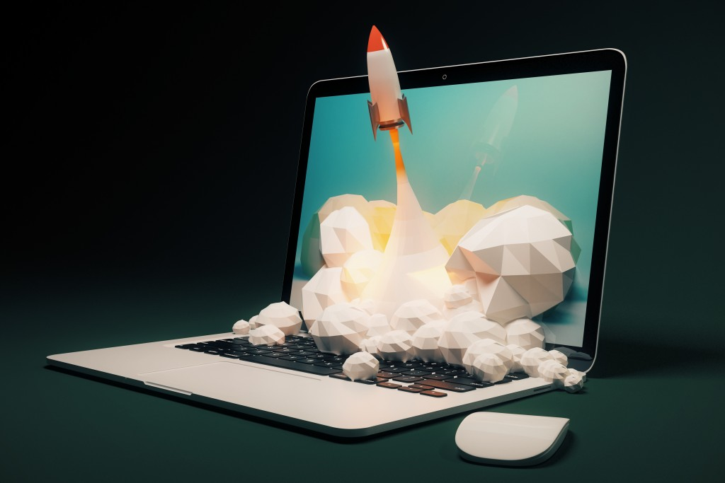 visual design of a miniature rocket blasting off from a laptop screen