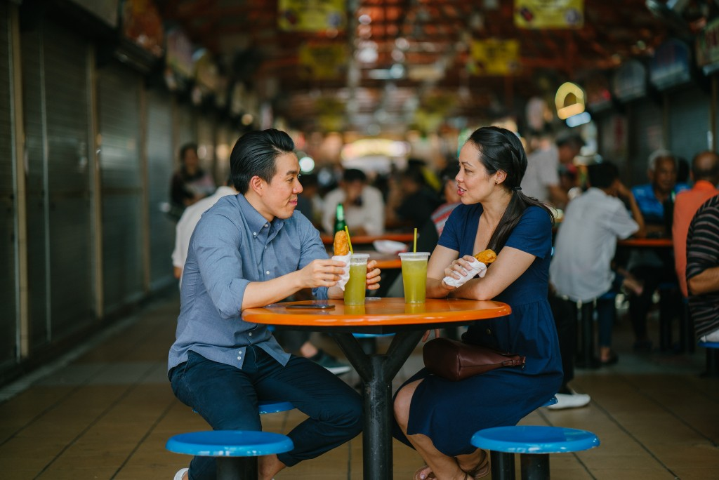 Couple eating in a food court