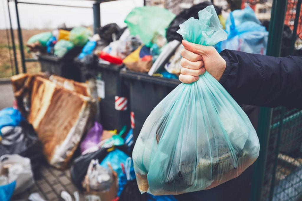 man throwing out garbage