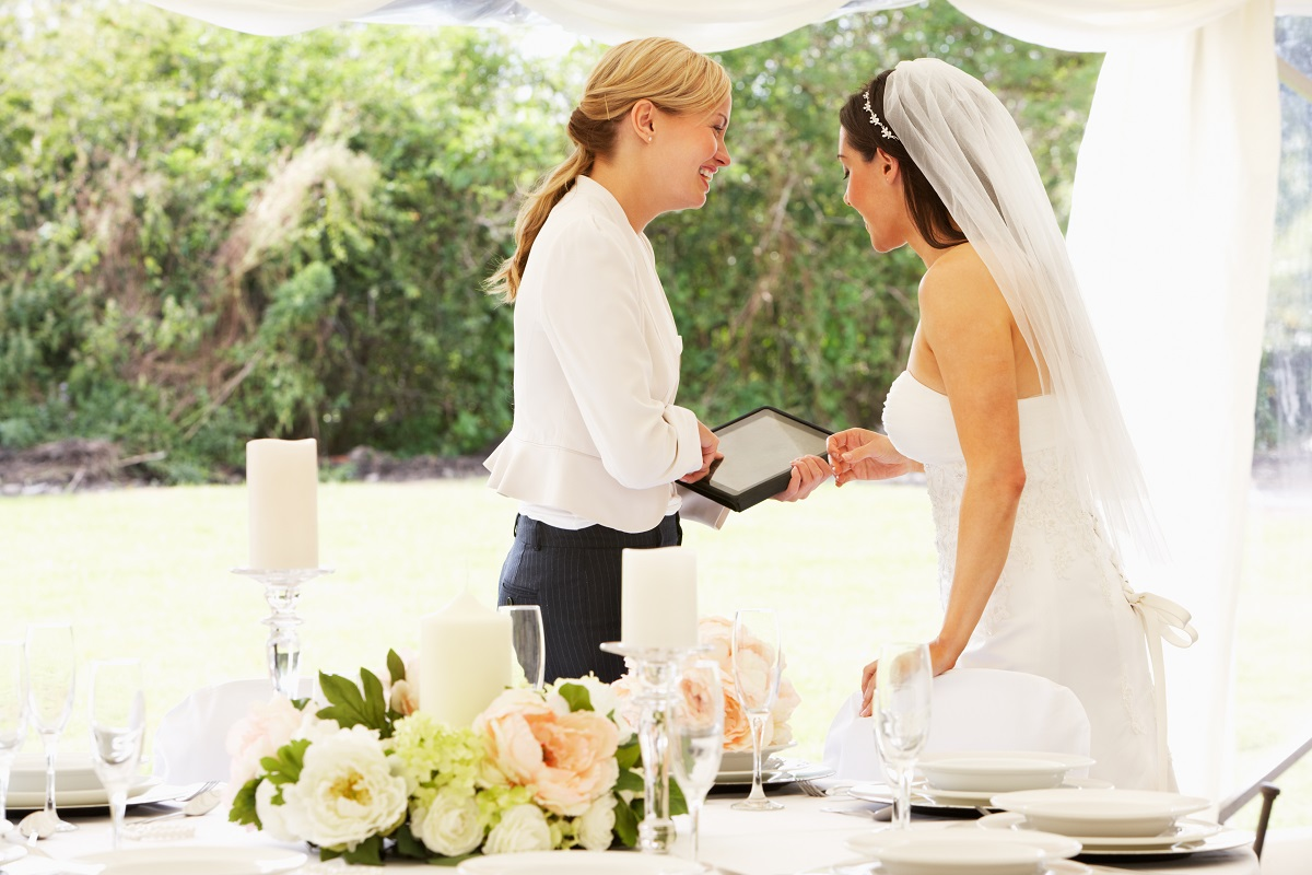wedding coordinator talking to the bride