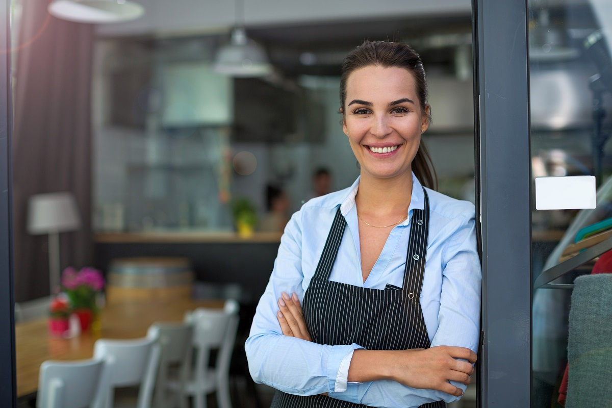 business owner in front of her restaurant