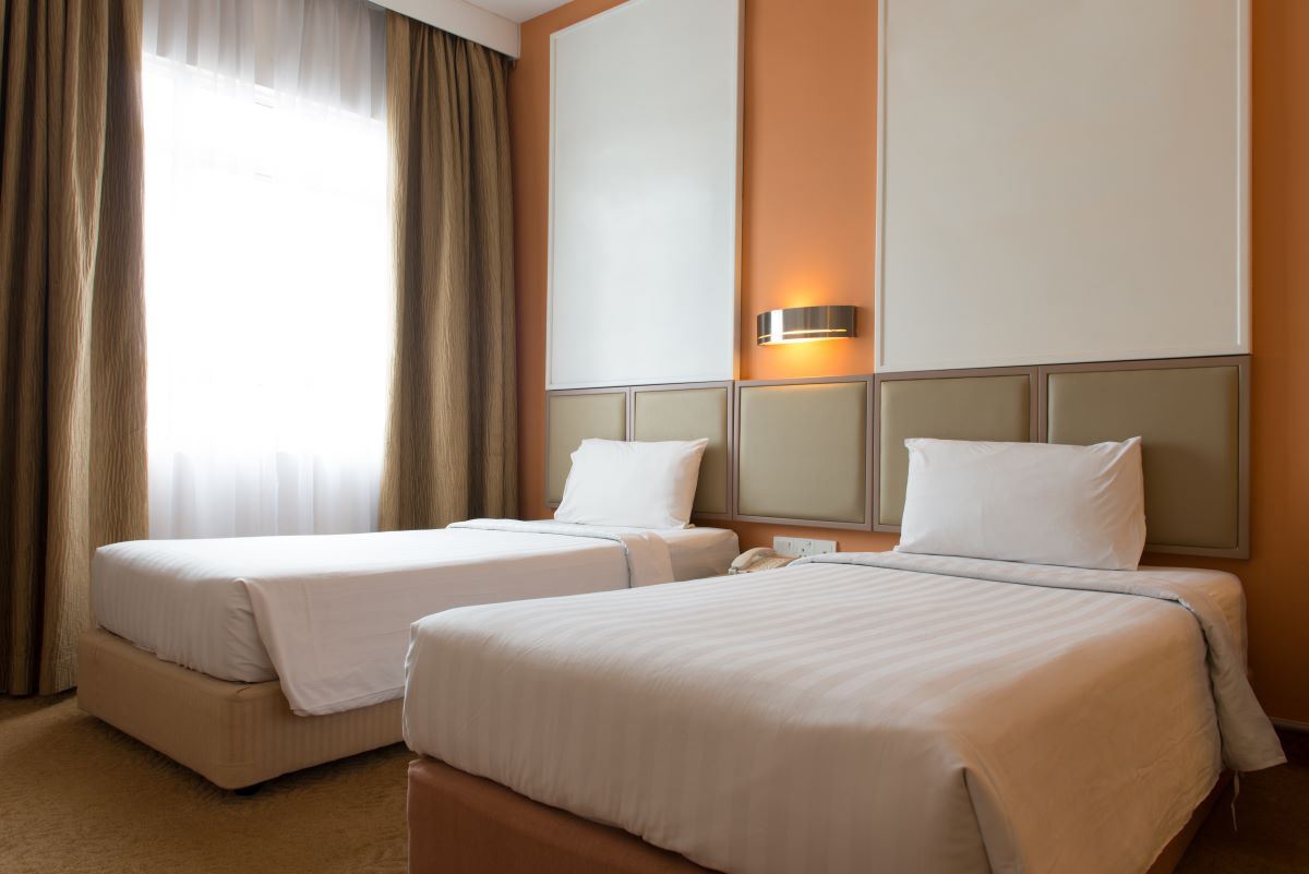 Interior of hotel bedroom with twin size bed