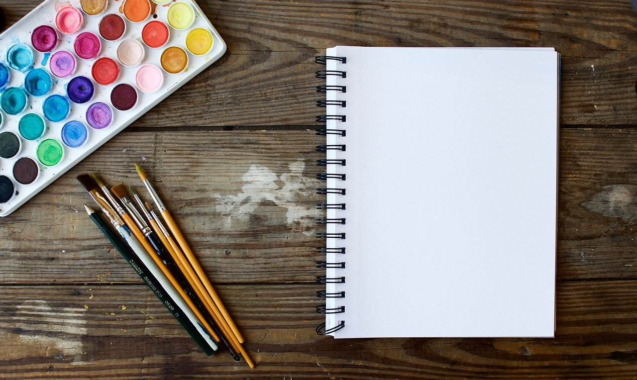 blank notebook and art materials