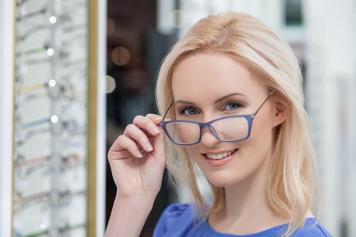 woman trying eyeglasses