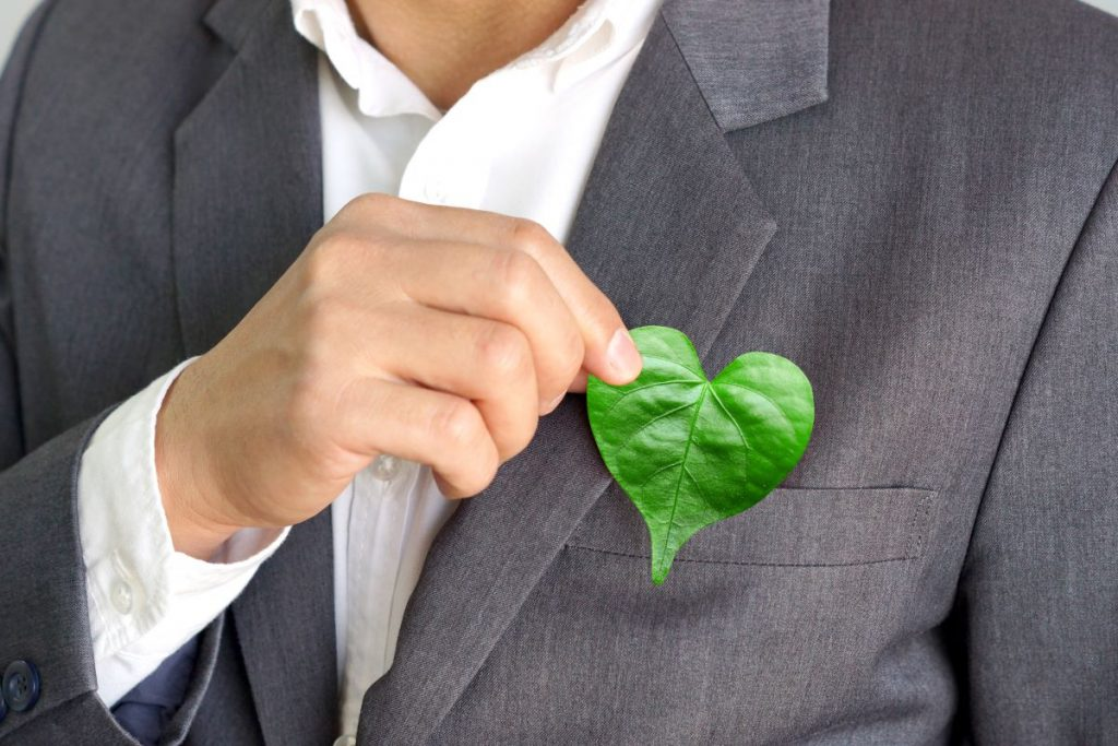 heart shaped leaf held by man