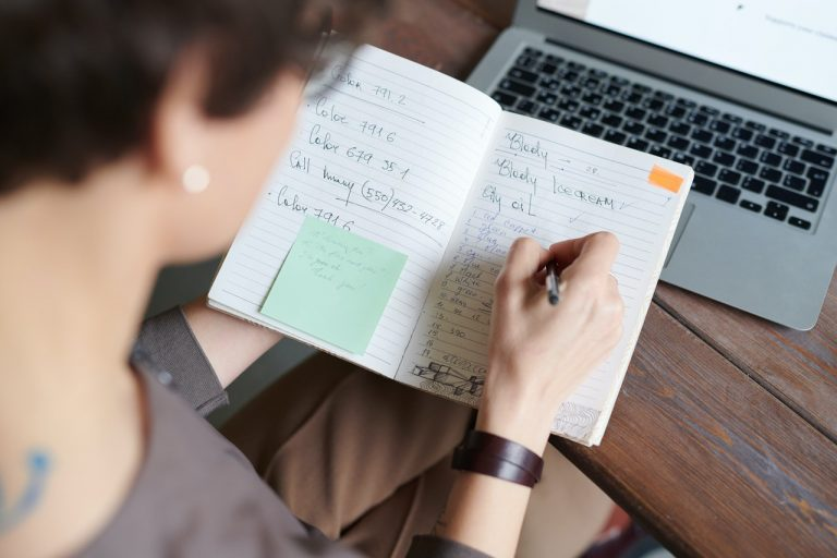 woman taking down notes