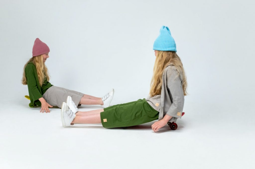 two girls sitting on the floor