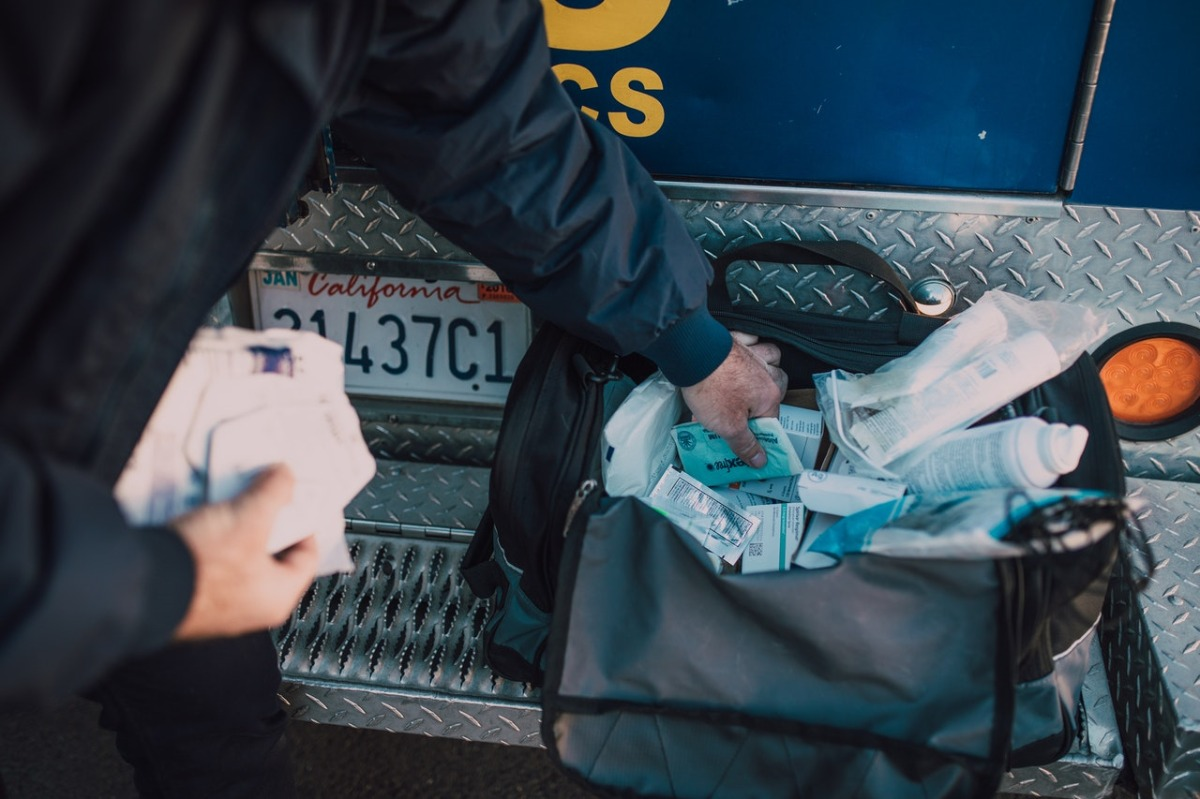 man inspecting a bag